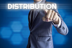 Business man touch modern interface for Distribution concept. On blue background royalty free stock images