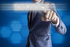Business man touch modern interface for Service concept. On blue background Stock Photography