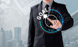 Business man touch rotate compass to goal direction Royalty Free Stock Photos
