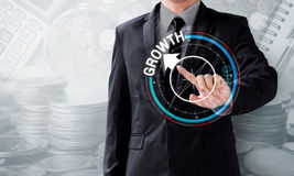 Business man touch rotate compass to growth Stock Image