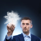 Business man touch splash of powder in air Royalty Free Stock Photos