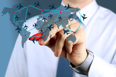 Business man touching  an airplane routes on world map. Royalty Free Stock Photography