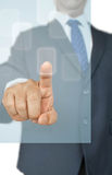 Business man touching button Stock Image