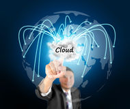 Business man touching cloud computing. Technology into world wide Stock Photos