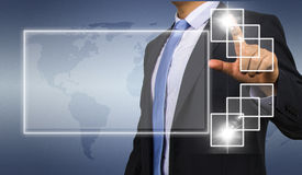 Business man touching display Royalty Free Stock Images