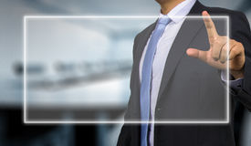 Business man touching display Royalty Free Stock Image