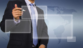 Business man touching display Stock Photos