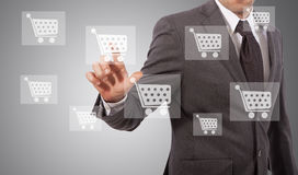 Ecommerce icon touh. Business man touching ecommerce icon on screen Royalty Free Stock Image