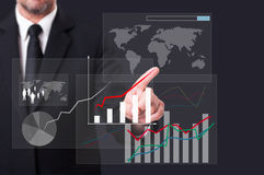 Business man touching a global chart icon on virtual screen Stock Photo