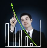 Business man touching graph Royalty Free Stock Photo