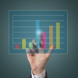 Businessman touch graph Royalty Free Stock Image