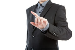Business man touching an imaginary screen. Stock Photography