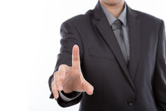 Business man touching an imaginary screen against Royalty Free Stock Photo