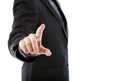 Business man touching an imaginary screen against Stock Photo