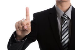 Business man touching an imaginary screen against Stock Photos