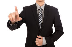 Business man touching an imaginary screen against Royalty Free Stock Photography