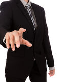 Business man touching an imaginary screen against Royalty Free Stock Images