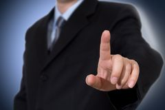 Business man touching imaginary screen royalty free stock images