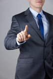 Business man touching an imaginary screen Royalty Free Stock Photo