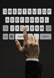 Business man touching imaginery screen with keypad Stock Photos