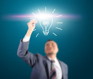 Business man touching light of idea Royalty Free Stock Images