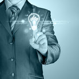 Business man touching light of idea Royalty Free Stock Photos