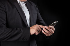 Business man touching on mobile phone screen use for connecting Royalty Free Stock Photos