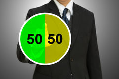 Business man touching on Pie chart with fifty-fift Stock Photography