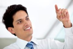 Business man touching a screen Stock Image