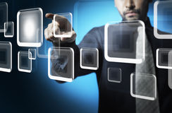 Business man touching screen Stock Image