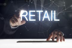 Business man touching screen with `Retail` writing. Business man touching the screen stock image