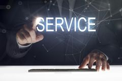 Business man touching screen with `Service` writing. Business man touching the screen royalty free stock images