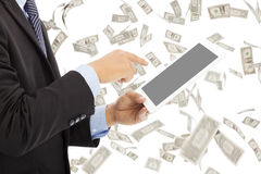 Business man touching tablet with money rain background Royalty Free Stock Photography