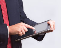 Business man touching tablet pc. Business man touching modern tablet pc , New Technology Royalty Free Stock Photos