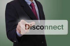 Business man touching touchscreen - Disconnect. Business man touching touchscreen with message - Disconnect royalty free stock photos