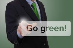 Business man touching touchscreen - Go Green Stock Images