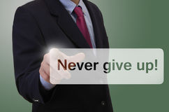 Business man touching touchscreen - Never give up ! Royalty Free Stock Photo