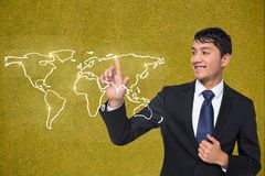 business man touching world wide map against yellow background Stock Image