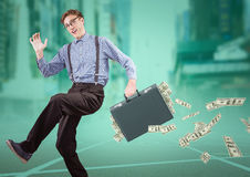 Business man on track with money falling out of briefcase against blurry city with teal overlay. Digital composite of Business man on track with money falling Stock Images