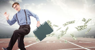 Business man on track with money falling out of briefcase against flares Stock Photo