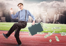 Business man on track with money falling out of briefcase against skyline with clouds. Digital composite of Business man on track with money falling out of Stock Photo