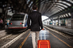 Business man at the train station Stock Photo