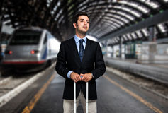 Business man at the train station Stock Image