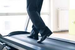 Business man training in gym. With laptop and mobil phone royalty free stock photos
