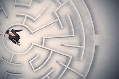 Business man trapped in a circular maze Stock Images
