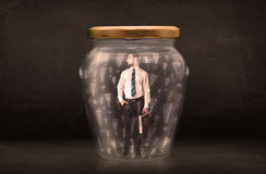 Business man trapped in jar with exclamation marks concept Royalty Free Stock Photos