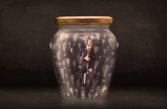Business man trapped in jar with exclamation marks concept Royalty Free Stock Image
