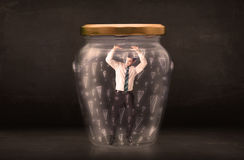 Business man trapped in jar with exclamation marks concept Royalty Free Stock Photo