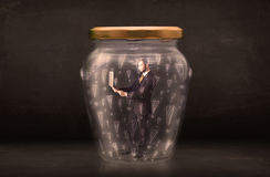 Business man trapped in jar with exclamation marks concept Royalty Free Stock Images