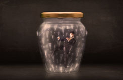 Business man trapped in jar with exclamation marks concept Royalty Free Stock Photography